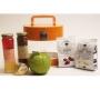 מזוודה שקופה לחג עם צנצנות דבש, שוקולד ופירות יבשים